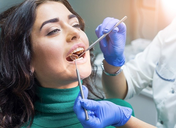 Woman receiving emergency dental treatment