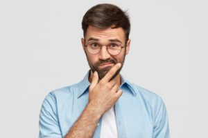 Man wondering if he's a good candidate for Invisalign in Brooklyn