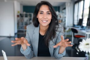 Confident businesswoman with Invisalign in Brooklyn