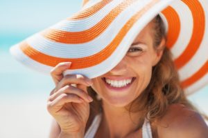 Smiling woman in sun hat without gum disease