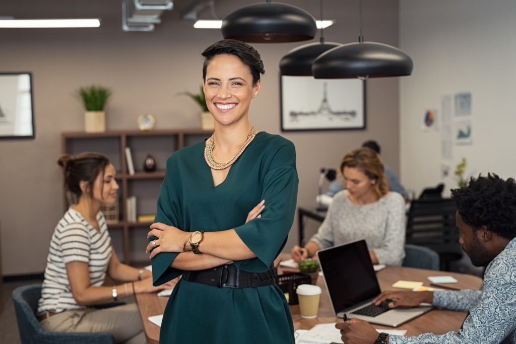 Female business professional smiling with white, straight teeth